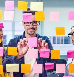 Three people planning with post-it notes