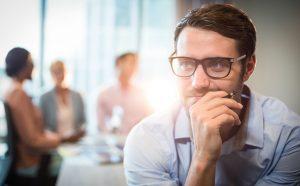 Employee contemplating Black Friday Cyber Monday 2020 data